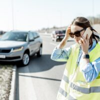 Woman calling during the road accident on the highway