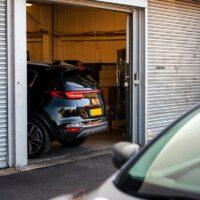 car leaving garage