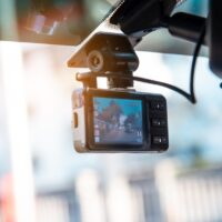 Car video camera attached to the windshield to record driving and prevent danger from driving