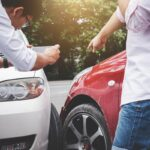 Two drivers man arguing after a car traffic accident collision and making phone call to Insurance Agent and take a photo, Traffic Accident and insurance concept
